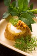 Baked potato with sour cream, grain Dijon mustard and herbs - stock photo