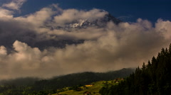 Eiger and Kleine Sheiddeg being covered in clouds Swiss alpine landscape 4K Stock Footage