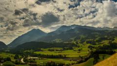 Berner Oberland alpine farmland landscape sunbeams time lapse 4K Stock Footage