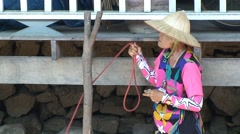 Old woman seller at Thai floating boat market at khlong canal. Thailand Stock Footage