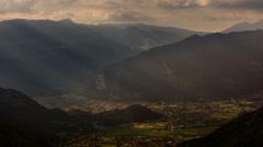 Interlaken village and valley sunbeams at sunset time lapse Stock Footage