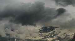 Les Diablerets high mountain landscape clouds covering peaks Stock Footage