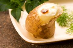 Baked potato with sour cream and fresh dill Stock Photos