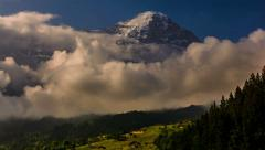 Eiger North face coverend in snow and ice Kleine Sheiddeg sunny meadows Stock Footage