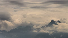 Rhone Alps mountai peak being covered by fast moving clouds Stock Footage