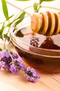 lavender honey with fresh flowers. sweet food - stock photo