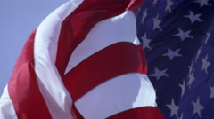 Shot of American flag waving and rolling in the breeze. - stock footage
