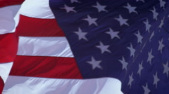 Close up of American flag waving in the breeze. - stock footage