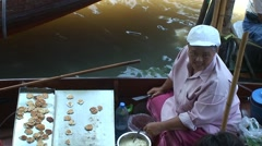 Woman sell food. Thai floating boat market at khlong canal. Thailand Stock Footage