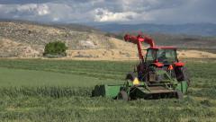 Tractor swather cut wheat grain farm field Utah 4K Stock Footage