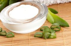 Aloe vera - leaves and face cream Stock Photos