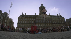 Shot of a juggler on a unicycle perfroming in front of the Royal Palace Stock Footage