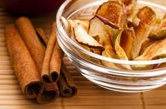 Dried apples with cinnamon - stock photo