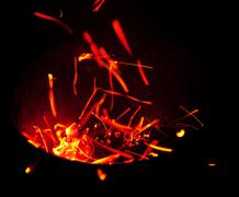 red sparks fly out of the container - stock photo