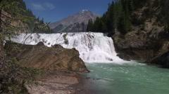Wapta Falls cascading down mountain valley river. Stock Footage