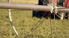 Static close-up shot of wheel irrigation system Stock Footage