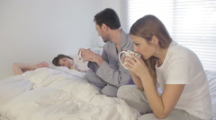 Parents are drinking some coffee while their childen are sleep Stock Footage
