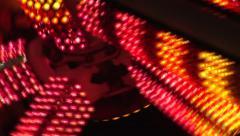 Dizzing brilliant flashing lights of carnival wheel ride at night. Stock Footage