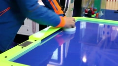Playing air hockey game Stock Footage