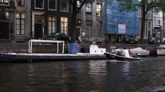 Shot of a boat moored near a street in Amsterdam Stock Footage