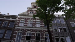 Shot of a beautiful ancient building on a street in Amsterdam Stock Footage