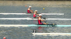 Men's single sculls rowing at the start of a race Stock Footage