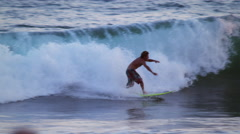Stock Video Footage of Shot of a young male surfer surfing along the coast in Costa Rica