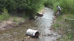 Grandkids floating homemade rafts mountain creek 4K - stock footage