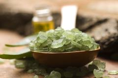 Aloe vera with bath salt and massage oil - stock photo