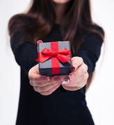 Female hands holding jewerly gift box - stock photo