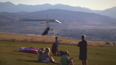 Shot of hang glider slowing and coming to a stop on top of a hill. Arkistovideo
