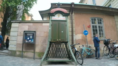 Rikstelefon - Traditional Telephone kiosk in Gamla Stan Stockholm - stock footage