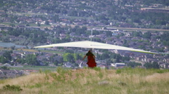 Hang glider is taking off from hill overlooking South Salt Lake valley in Utah. - stock footage