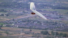 Stock Video Footage of Person is Hang gliding near the Jordan, South Salt Lake Valley.