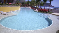 Static shot of a pool outside a resort. Stock Footage