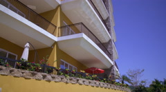 Panning shot of a resort building to an outdoor pool. Stock Footage