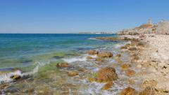 People relax on the Black Sea near the ruins of the ancient city of Chersonesos. Stock Footage