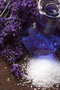 Lavender flowers with the bath salt and essential oil - stock photo