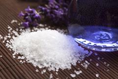 Lavender flowers and the bath salt and essential oil - stock photo