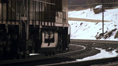 Shot of frieght train rounding a curve in wintertime. Stock Footage