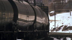 Stock Video Footage of Shot of steel cargo train as it rounds a curve.