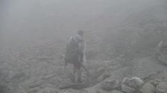 Hiker Engulfed in Fog Stock Footage