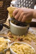 Detail of child hands making plum tart - stock photo