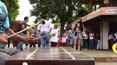 3956 June 2015 Nicaragua - Man Playing Xylophone in Open Street Corner Stock Footage