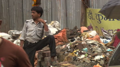 Mumbai Man standing by rubbish tip Stock Footage