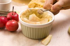 Detail of child hands making apple pie - stock photo
