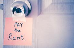 sticky note write a message pay the rent - stock photo