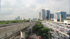 BTS Skytrain coming to Mo-chit station in Bangkok, Thailand Stock Footage
