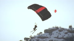 Base jumper soaring through the air wearing skis in slow motion. Stock Footage