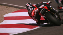 Slow motion shot of motorcycle racers on the race track Stock Footage